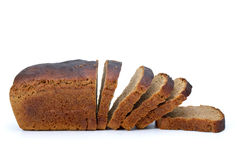 Chunk of rye bread with anise and some slices. Isolated on the white background Royalty Free Stock Photo