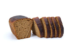 Chunk of rye bread with anise and some slices Stock Photography