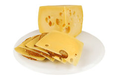Chunk of yellow cheese with slices Stock Photos