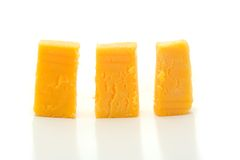 Chunks of Cheese. A macro shot of three chunks of cheese over a white background Royalty Free Stock Image