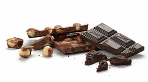 Chunks of chocolate. Chunks of milk and dark chocolate on a white background Royalty Free Stock Photos