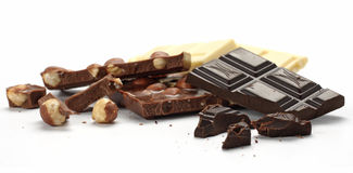 Chunks of chocolate. Chunks of dark, milk, and white chocolate with nuts Royalty Free Stock Images