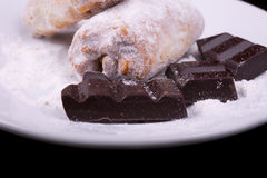 Chunks of chocolate and a bagel Stock Photos