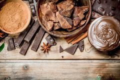 Chunks of crushed chocolate with chocolate paste and ground cocoa stock image