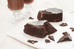 Chunks of dark chocolate and cocoa beverage Stock Photography