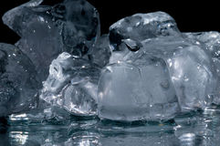 Chunks of ice lay on the ground Royalty Free Stock Images