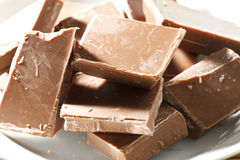 Chunks of milk chocolate Royalty Free Stock Photos