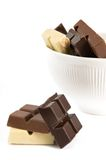 Chunks of milk, dark and brown. Mix of different types of chocolate on the white background stock photography