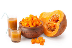Chunks of pumpkin and pumpkin juice Royalty Free Stock Photos