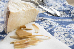 Chunks and rind of parmigiano cheese Royalty Free Stock Photo