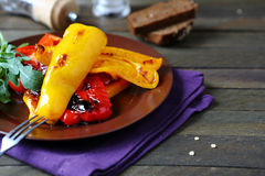 Chunks of roasted peppers on a plate Stock Photo