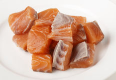 Chunks of salmon on a plate Stock Images