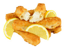 Chunky Breadcrumb Coated Cod Fish Fingers. Cooked chunky bread crumb covered cod fish fingers with lemon isolated on a white background Royalty Free Stock Photo