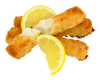 Chunky Breadcrumb Coated Cod Fish Fingers. Cooked chunky bread crumb covered cod fish fingers with lemon isolated on a white background Royalty Free Stock Photos