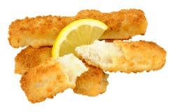 Chunky Breadcrumb Coated Cod Fish Fingers. Cooked chunky bread crumb covered cod fish fingers with lemon isolated on a white background Stock Photo
