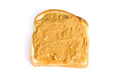 Chunky peanut butter sandwich on white. An open crunchy peanut butter sandwich made with white bread is on white background Stock Photo