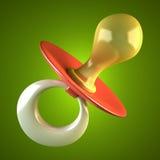 A chupeta do bebê cor-de-rosa isolada no fundo verde Imagem de Stock Royalty Free