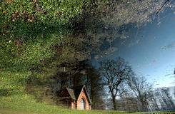 Church. In denmark a sunny summer day viewed from the edge of a lake with the  reflexion Royalty Free Stock Images
