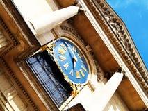 Church. Clock on a church facade Royalty Free Stock Images
