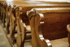 Church. Old, wooden benches of church royalty free stock photography