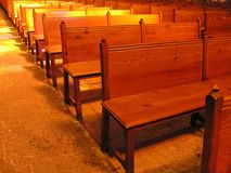 In the church... Available light shot of pews Royalty Free Stock Image