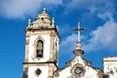 Church. Details the campbell tower and the central cross of Ordem Terceira de Sao Domingos de Gusmao Church, located at Pelourinho, historical center of Salvador stock photo