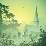 Church. A Misty Landscape with Church and Graveyard Stock Images