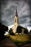 Church. Opposition of the storm sky and church Stock Photography