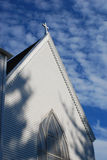 Church. A beautiful white church on a brite summer day where the sky is a rich blue with scattered clouds Royalty Free Stock Photography