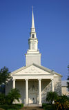 Church. Front of church with tall columns and tall steeple royalty free stock photography