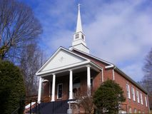 Church. Baptist church in rural North carolina. Showing front and side of brick church. beautiful Steeple also shown Royalty Free Stock Photos