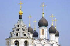 Church. Domes of church on blue sky Stock Images