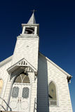 Church. View of facade of old-fashioned white wooden church against clear blue sky Stock Photography