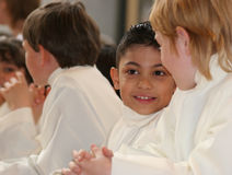 In the church. Children in the church on communion day Royalty Free Stock Photos