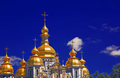 The church against the blue sky. Summer blue sky Orthodox Church Royalty Free Stock Photos