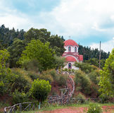 Church against cloudy sky in the middle of forest. Small orthodox church against cloudy sky in the middle of forest Royalty Free Stock Photography