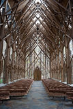 Church Aisle. The center aisle of a wooden and glass church Royalty Free Stock Images