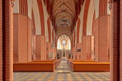 Church aisle leading to altar. Inside a church showing the wood pews and the aisle leading to the altar Stock Photos