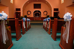 Church aisle for wedding. A church aisle decorated for a wedding ceremony royalty free stock photography