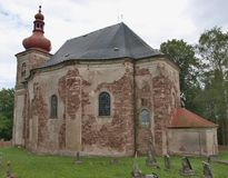 The Church of All Saints is a Roman Catholic church in Hermankov. Ice. It belongs to the Broumov group of Baroque churches. It is protected as a cultural Royalty Free Stock Photo