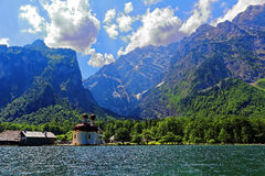Church in alpine landscape at lake Königssee Stock Photo