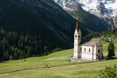 Church in Alpine mountains. Serene picture Royalty Free Stock Images