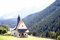 Church in Alps. A church in the middle of nowhere in the Alps. Only some horses are around Stock Image