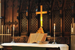 Church altar. With Bible and candles Royalty Free Stock Photography