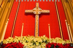 Church altar with poinsettias stock photography
