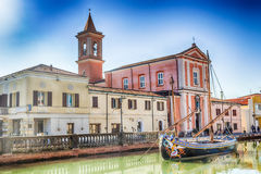 Church and ancient sailboats on Canal Port Stock Photos