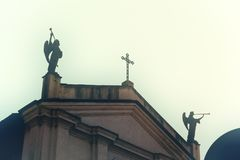church with angles playing trumpet - body copy - halloween and horror mood . royalty free stock photography