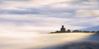 Church in Aramaio surrounding by fog. Azkoaga village Royalty Free Stock Images