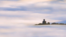 Church in Aramaio surrounding by fog Royalty Free Stock Image