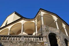 Church arcade. St. Gaudenzio church against blue sky, Varallo Sesia, Piedmont, Italy Royalty Free Stock Photos